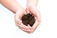Vruchtbare grond in handen Royalty-vrije Stock Foto