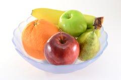 Vruchten in een kom Stock Afbeeldingen