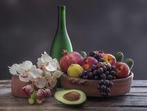 Vruchten en Orchideeën stock afbeelding