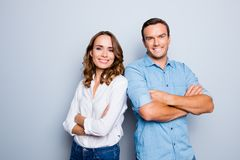 He vs she happy together. Close up portrait of attractive, cauca. Sian, lovely, cute, adult couple in casual outfit  looking at camera standing with crossed arms Royalty Free Stock Photography