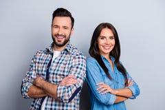He vs She portrait of caucasian, hispanic couple in shirts - man. He vs She portrait of caucasian, hispanic couple in shirts - men with bristle and pretty Stock Images