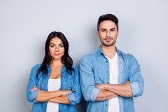 He vs She portrait of caucasion hispanic couple in jeans shirt - Stock Photos
