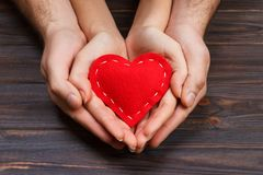 He vs she together forever. Love story, beautiful hand hold holding red heart.  Stock Image