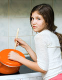 VTeen girl with pan. Teen girl with pan in kitchen Stock Photo