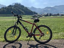 A VTT bicycle and a beautiful landscape château de Gruyères stock photos