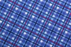 Vue à angles des modèles carrés bleus sur le tissu Photos libres de droits
