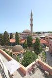 Vue à Suleiman Mosque de tour d'horloge de Roloi dans la vieille ville de Rhodes La Grèce image libre de droits
