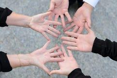 Vue aérienne de trois amis et de leurs mains Photographie stock