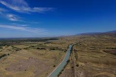 Vue aérienne des montagnes et de la route Images libres de droits