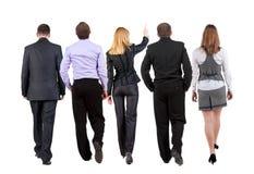 Vue arrière d'équipe de marche d'affaires Image libre de droits