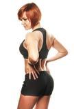 Vue arrière d'athlète féminin d'ajustement sur du fond blanc Photographie stock libre de droits