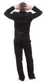 Vue arrière d'homme choqué d'affaires dans le costume noir Images libres de droits