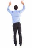 Vue arrière d'homme d'affaires soulevant ses bras Photos libres de droits