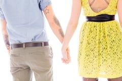 Vue arrière d'un couple lesbien se tenant avec tenir des mains Photographie stock