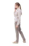Vue arrière d'une femme parlant au téléphone Photographie stock