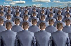Vue arrière de beaucoup d'hommes d'affaires Photo stock