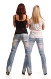 Vue arrière de deux filles dedans fortement Photo libre de droits