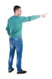 Vue arrière de diriger des jeunes hommes dans des jeans Photographie stock libre de droits