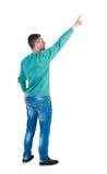 Vue arrière de diriger des jeunes hommes dans des jeans Photo stock