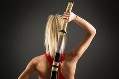 Vue arrière de femme avec l'épée images stock