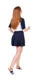 Vue arrière de femme courante dans la robe Image libre de droits