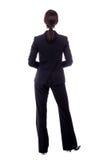 Vue arrière de femme d'affaires dans le costume noir d'isolement sur le blanc Photographie stock