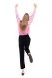 Vue arrière de femme d'affaires A soulevé son poing dans le signe de victoire Photographie stock libre de droits