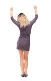 Vue arrière de femme d'affaires A soulevé son poing dans le signe de victoire Photo stock