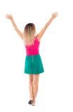 Vue arrière de femme d'affaires A soulevé son poing dans le signe de victoire Photos stock
