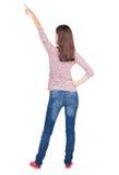 Vue arrière de femme de pointage Image stock
