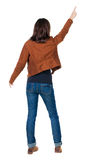 Vue arrière de femme de pointage Photos stock