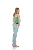 Vue arrière de femme sexy dans des jeans fanés Images libres de droits
