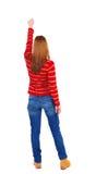 Vue arrière de femme A soulevé son poing dans le signe de victoire Photos stock
