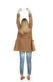 Vue arrière de femme A soulevé son poing dans le signe de victoire Photo stock
