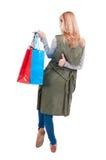 Vue arrière de fille de mode aux achats Photo libre de droits