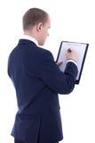 Vue arrière de jeune homme d'affaires dans l'écriture de costume quelque chose dans l'agrafe image libre de droits