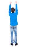 Vue arrière de l'homme A soulevé son poing dans le signe de victoire Photo stock