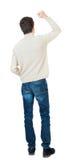 Vue arrière de l'homme A soulevé son poing dans le signe de victoire Image stock