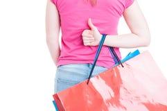 Vue arrière de main de femme faisant le thumbup ou comme le geste Photos libres de droits