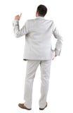 Vue arrière de penser le jeune homme d'affaires dans le costume blanc. Photographie stock libre de droits