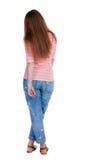 Vue arrière de tenir la jeune belle femme rousse Images libres de droits