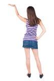 Vue arrière de belle jeune femme étonnée de brune Photographie stock libre de droits
