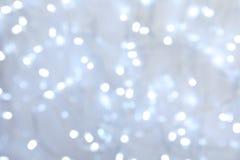 Vue brouillée des lumières de Noël comme fond photo stock