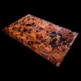 Vue d'un plat d'obsidien sur un fond noir photographie stock