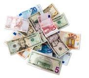 Vue de billets de banque d'euro et de dollar première avec le chemin de découpage Photographie stock libre de droits