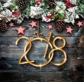 Vue de 2018 bonnes années et de Joyeux Noël avec la neige et le rea image stock