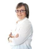 Vue de côté de gestionnaire féminin aîné de sourire Photographie stock libre de droits