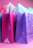 Vue de côté de trois sacs à provisions. Image libre de droits
