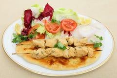 Vue de côté de tikka de poulet Photos stock