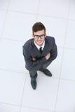 Vue de ci-dessus d'un jeune costume de port de sourire d'homme d'affaires et Photographie stock